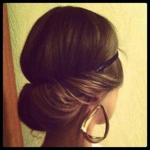 Romantic hairstyle for brown long hair. Headband.