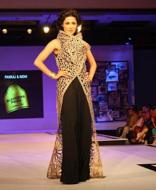 Shimmering flashes of gold set runways ablaze as Chitrangada Singh walks the runway for Pankaj and Nidhi.