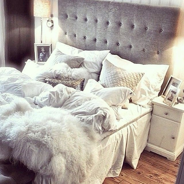 I love this tufted bed with white bedding and white quilted pillows & silver decorative pillows.: