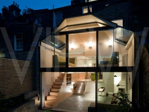 Victoria Park House, Ian Hay Architects, London, 2010, Rear elevation showing glass extension (at dusk).