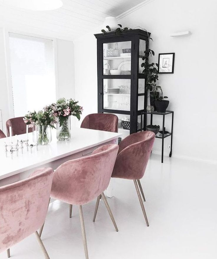 Cabinet and chairs adding colour to a neutral space