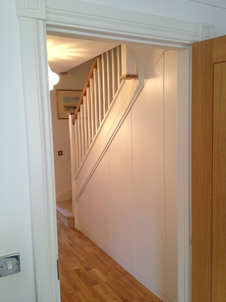 Bespoke Under-stairs storage with doors by Anthony Mullan furniture