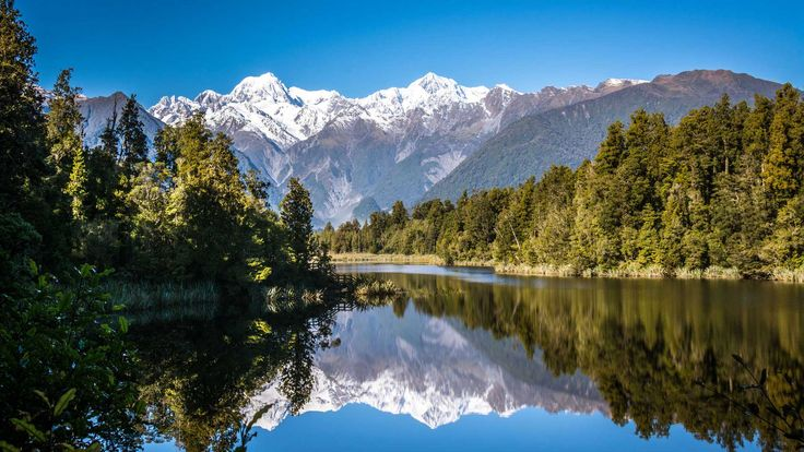 The unsurpassed views and mountain reflections from the forested shores of Lake Matheson make this easy walk, suitable for children, one of the most popular on the West Coast.
