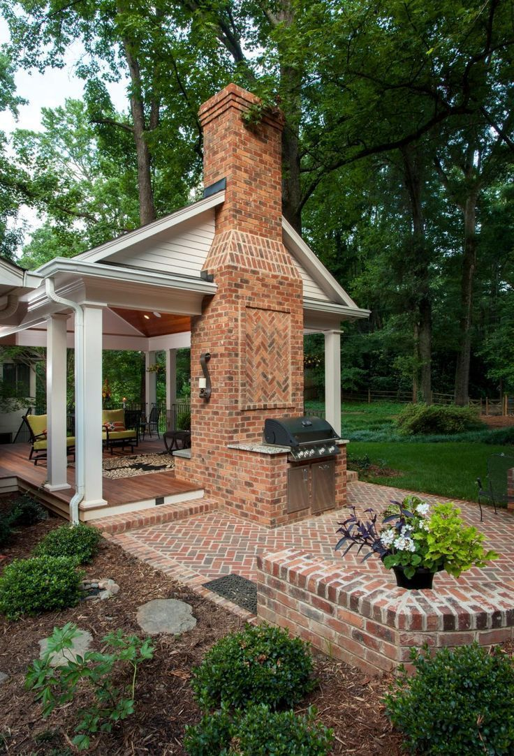 A backyard retreat with covered porch and open patio. Wood burning fireplace and grill area. Ip� decking for porch floor.