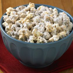 Peanut Butter Popcorn Munch... Peanut butter coated popcorn and pretzel recipe that resembles 'puppy chow' for a quick sweet treat