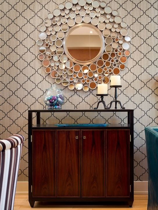 The Design Features Dozens Of Small Mirrors And A Large Beveled Round Mirror In Satin