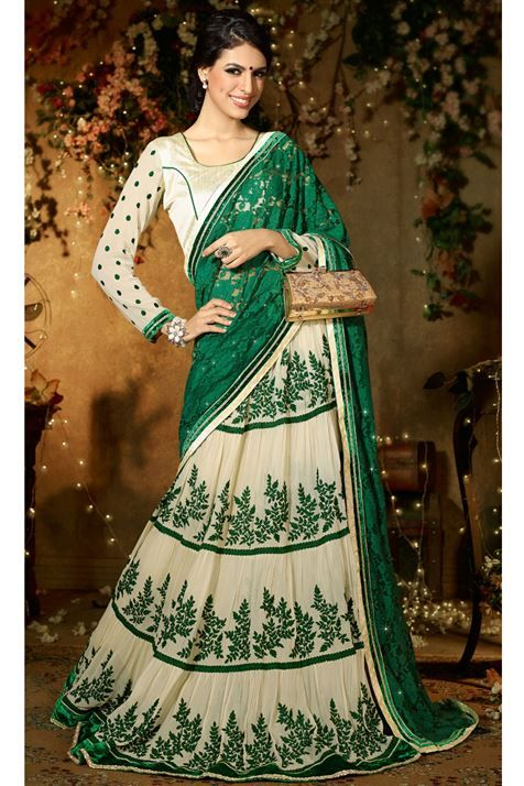 Show off your elegance with this Cream, Green Net Lehenga Saree @ FLAT 50% off. No coupon code required.