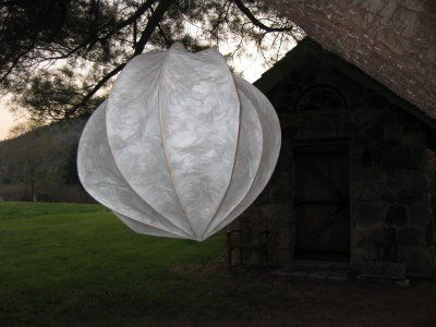 Paper Cloud Lantern > made from rice paper + basket reeds so should completely burn up in sky.  Substitute wooden dowels + thin wire + tissue paper + I'm afraid the wire + dowels wouldn't burn up properly.  No pollution just for pretty effects :(