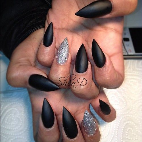 I really hats this whole pointed nails look, but love the matte black with shiny silver combo