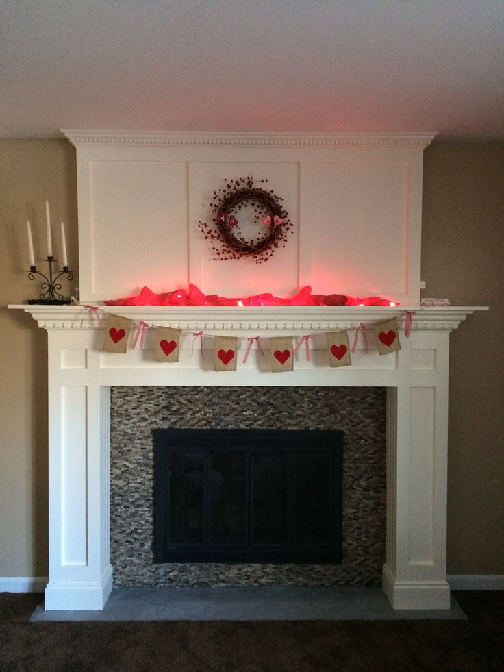 #valentine mantle pink twine, burlap flags with felt hearts, red gingham ribbon; pink burlap wrapped around pink/red/purple light strand #acmoore