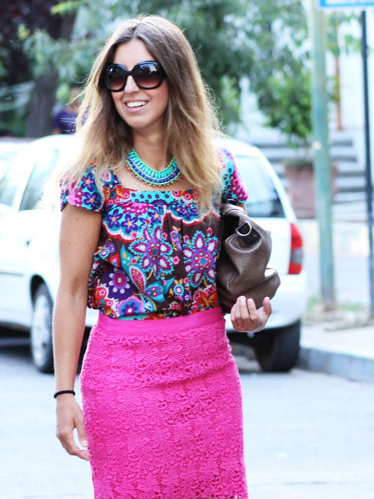 Shop this look on Lookastic:  https://lookastic.com/women/looks/multi-colored-short-sleeve-blouse-hot-pink-pencil-skirt-brown-clutch-aquamarine-necklace/9762  — Multi colored Floral Short Sleeve Blouse  — Brown Leather Clutch  — Aquamarine Necklace  — Hot Pink Lace Pencil Skirt