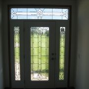 Legacy front door with sidelights and transom above by Rochester Homes | www.rochesterhomesinc.com