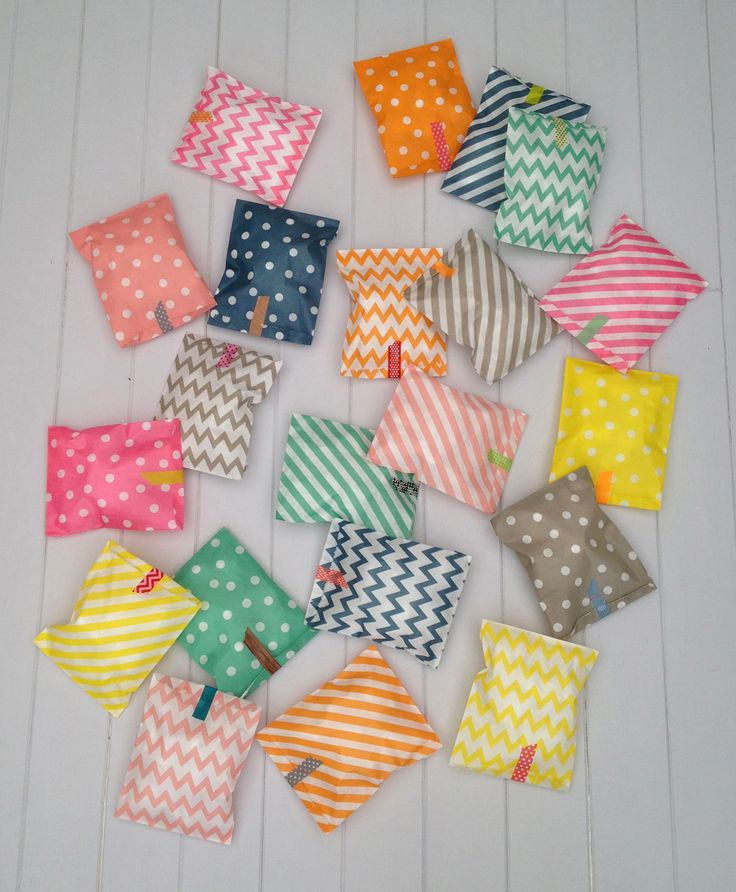 paper party bags with washi tape- I think these are cute for a little Valentine treat!