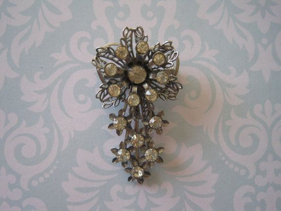 US$15.00 plus shipping!  https://www.etsy.com/ca/listing/209455532/vintage-silver-floral-stone-brooch?ref=shop_home_active_21