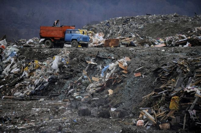 Dump trucks unloaded garbage at a dumping ground near the village of Gorny Vozdukh, outside of the Russian Black Sea resort of Sochi on Feb. 21.