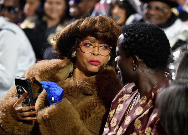 Host Erykah Badu (L) and Michael Blackson attend the 2017 Soul Train Awards, presented by BET, at the Orleans Arena on November 5, 2017 in Las Vegas, Nevada. - BET Presents: 2017 Soul Train Awards - Backstage & Audience
