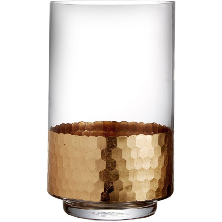 This glass container with a gold accented finish makes for a lovely piece when candle inside is lit.