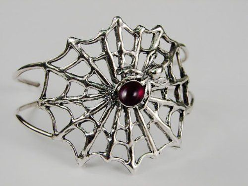 An Impressive Sterling Silver Spider Web Bracelet Accented with Genuine Garnet The Silver Dragon- Bracelets. $190.00. This Bracelet Fits a Standard Woman's Wrist. This Bracelet was Designed by The Silver Dragon, a Jewelry Shop in New England. Thank you for Supporting American Business.. The Silver Dragon uses Sterling Silver that has been Reclaimed... Helping Save Mother Earth's Resources.. Designed And Hand- Crafted in Sterling Silver. This Unique Bracelet is Created only aft...