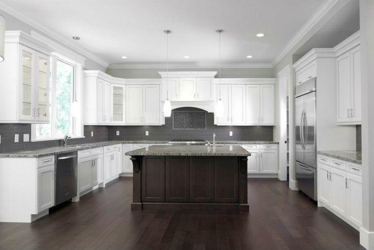 white kitchen cabinets quartz counters dark stain island