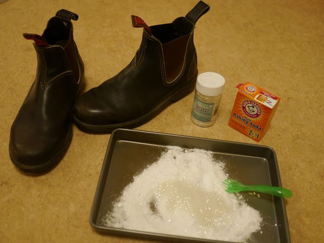 Spray the bottom of the boots with water, then use baking soda and glitter to create footprints from santa!