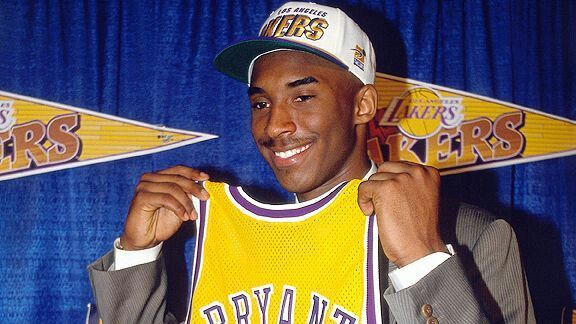 Kobe Bryant on draft day 1996 holding LA Los Angeles Lakers number 8 jersey.