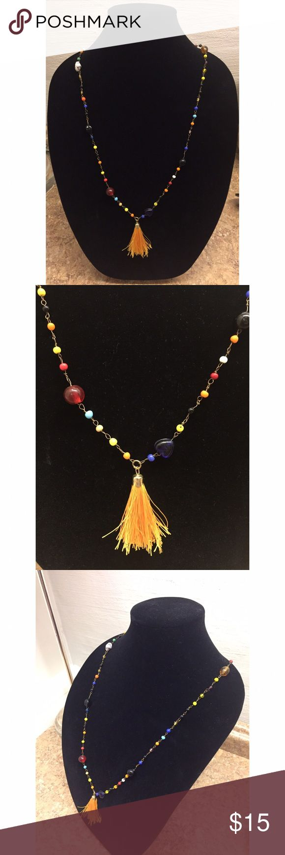 "Multi-colored beaded chain necklace with tassel Multi-colored beaded chain necklace with tassel. Total chain length is 38"", and necklace hangs 19"" from neck. Love these bright fun colors for the warmer months! Never been worn and in great condition! Jewelry Necklaces"