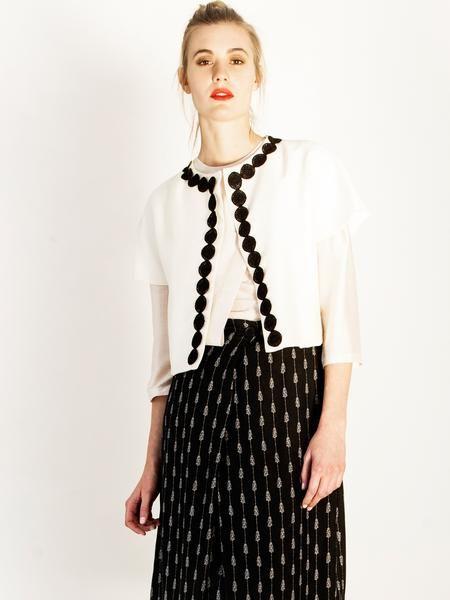 All day Autumn-Winter look / Short sleeve collarless jacket / Ecru wool / black trim detail / Black print midi skirt