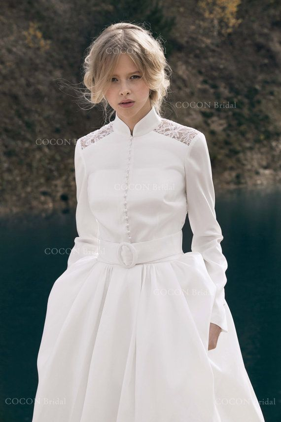Beautiful and elegant winter wedding a-line straps wedding dress Corsica made of mikado silk. Hidden zip on skirt and lace-up on bodice. The model