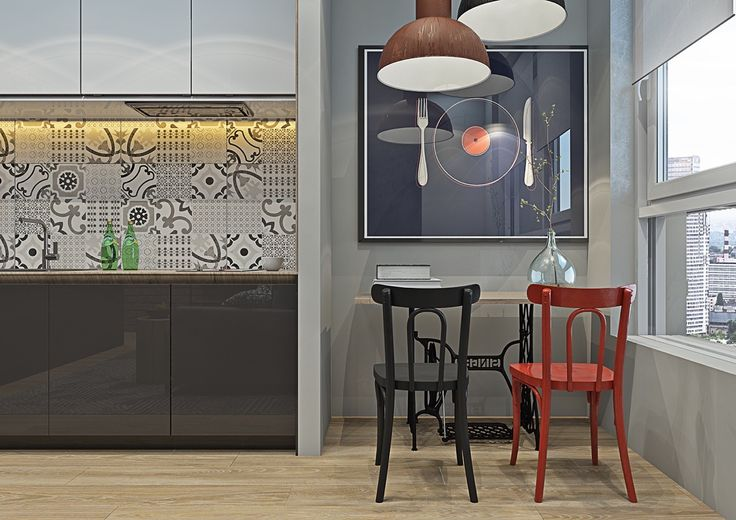 From the kitchen, a wall partition creates space for a dining room. Lit by industrial copper lighting, perfectly mis-matching red and black chairs work with a dinner-plate vinyl, shadowed by the inspirational quote to the side. A glass bauble vase mimics the living room light, a stencilled table-bottom the study.