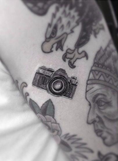 cannon camera tattoo by dr woo ssc at mark mahoney's shamrock social club.