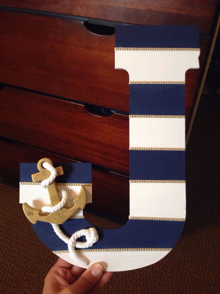 Alicia's baby boy shower 10/3/15: DIY painted nautical wooden letter with anchor, rope, and ribbon. https://www.facebook.com/shorthaircutstyles/posts/1759020237721749