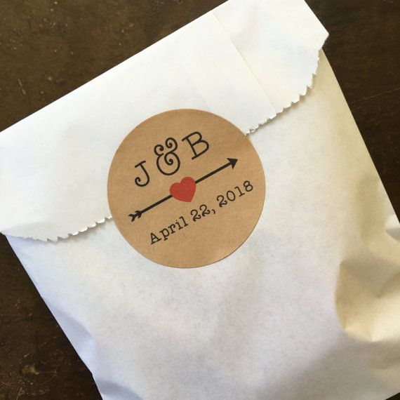 Personalized wedding favor labels, set of 20, from Clementine Weddings.  Beautiful round labels are the perfect finishing touch for your wedding, shower, or party favors! High quality, permanent self-adhesive labels, in white or kraft brown. Labels are available in quantities of 20.