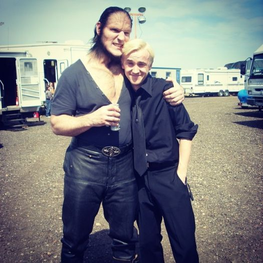 Dave & I on Half Blood Prince, he was sometimes scary on the outside but was always soft on the inside. A sweet, gentle man who was often disguised as a brute. He'll be missed. Thank you for all the good times mate x #davelegeno credit: Tom Felton