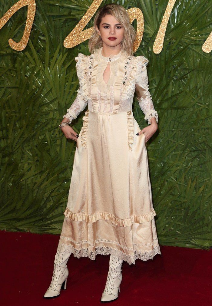 Selena Gomez wearing a Coach custom midi dress at the 2017 Fashion Awards held at Royal Albert Hall in London, England, on December 4, 2017