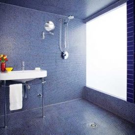 Inspired by Indian spas & Turkish baths, this bathroom is a pure wet room with no countertops or tubs, just a sink & shower head!