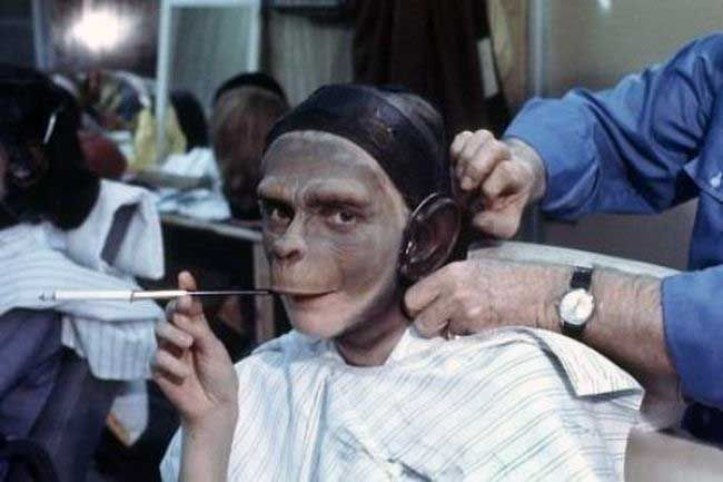 Kim Hunter Kim Hunter smoking a cigarette while getting her makeup done for Planet of the Apes.