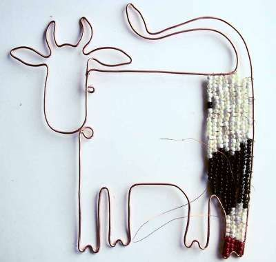 Click through to see gorgeous and fun wire-filled shapes for jewelry, suncatchers, wall, etc. essentially creating a bead loom out of wire