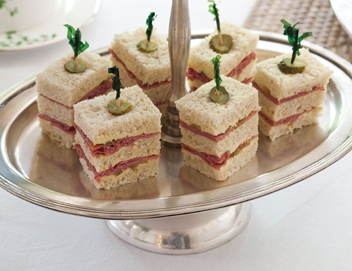 Traditionally, tea sandwiches are dainty little bites, but these triple-stack Corned Beef Tea Sandwiches, made with hearty oatmeal bread, are enough to make a meal.