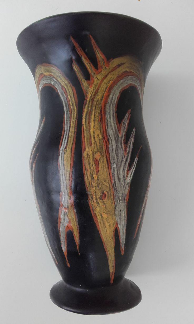 Orange pike on black vase