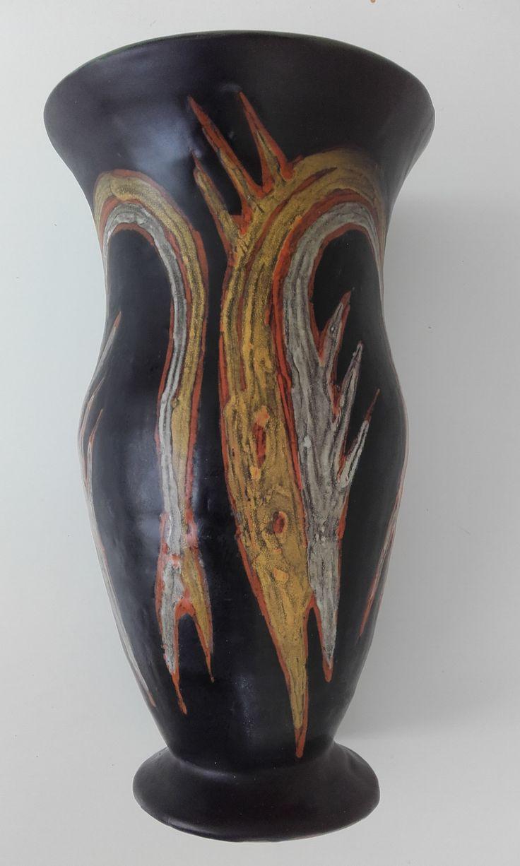 Orange pike on black vase