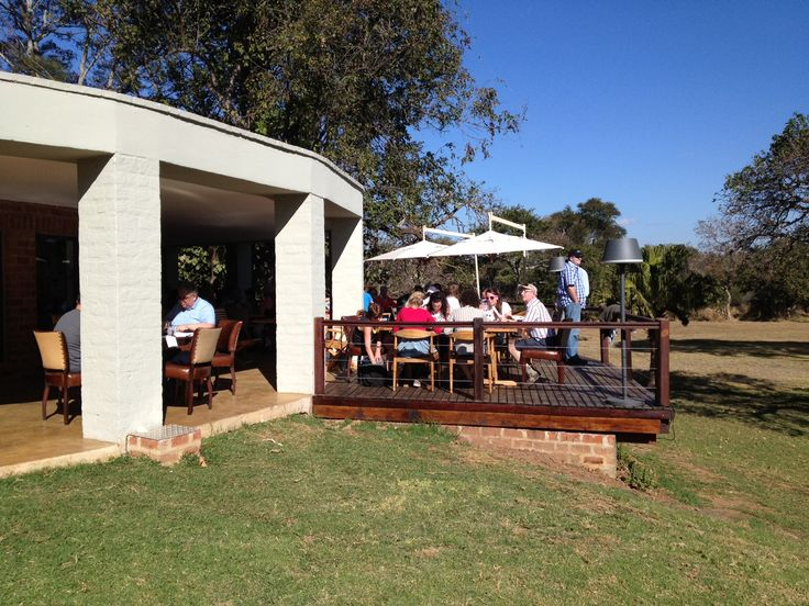 Guests enjoying a casual afternoon lunch at the Lilayi resort