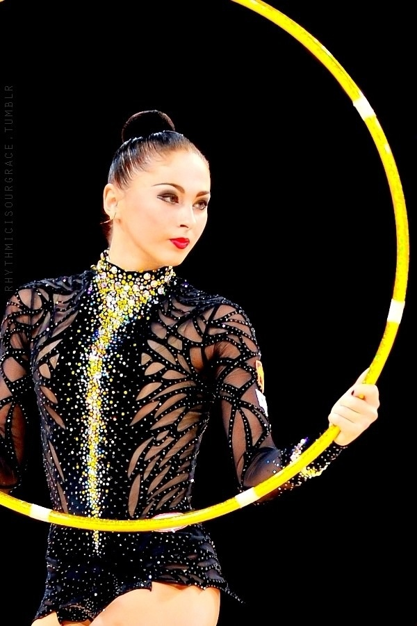 Дарья Кондакова ... pinned as I noticed there's an under-leotard with a black and lime  leotard over it.