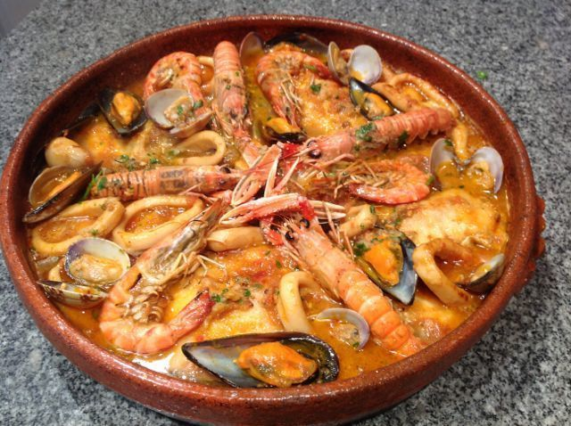 Zarzuela de pescados y mariscos, personally I love cooking in casuelas. It more authentic and the food tastes different.