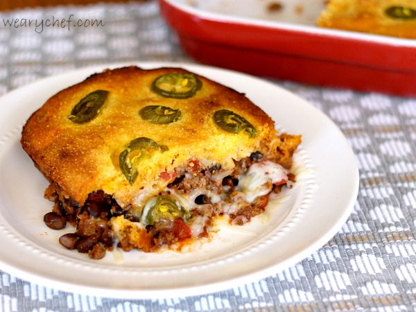 Chili Cornbread Pot Pie: Seasoned meat, tomatoes, and beans are topped with an easy, made-from-scratch cornbread batter for a hearty, satisfying dinner!