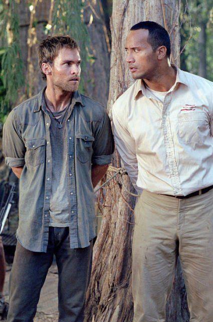 The Rundown (2003)  Stars: Dwayne Johnson, Seann William Scott, Christopher Walken