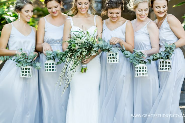 beach wedding bridesmaids and bride, teal blue inspiration luxury south african beach wedding, palm berries   http://www.absoluteperfection.co.za/#!CHANTELLE-AND-RJS-ROMANTIC-INTIMATE-BEACH-WEDDING/c1jar/57ad8b610cf2d58e4d0423e6