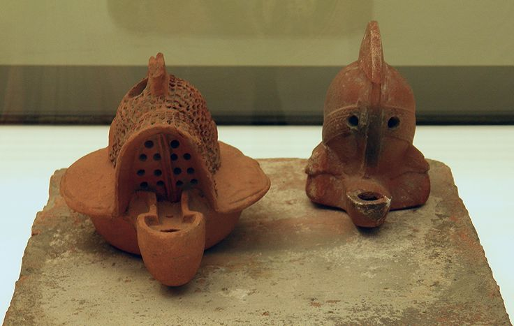 Terracotta oil lamps in the form of a Gladiators' helmets (Berlin Type Murmillo helmet on the left and a Secutor helmet on the right), 1st century CE. Romisch-Germanisches Museum, Cologne