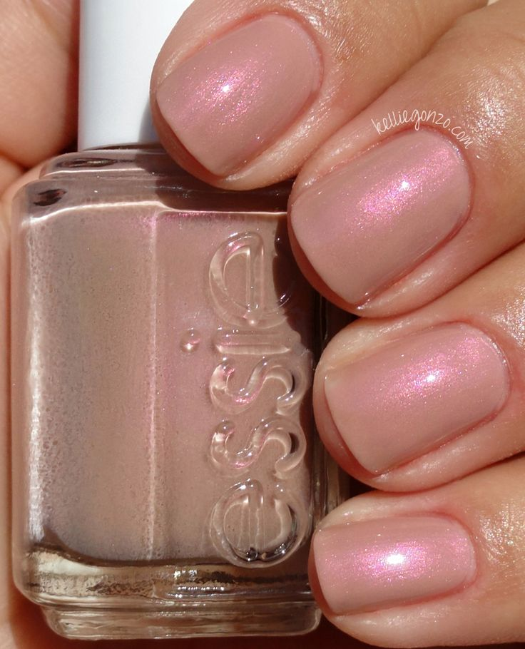 Essie Sand of a Beach. Love the name and the color even more. This is my idea of a perfect polish shade: a nude with rainbow iridescence! Gorgeous!