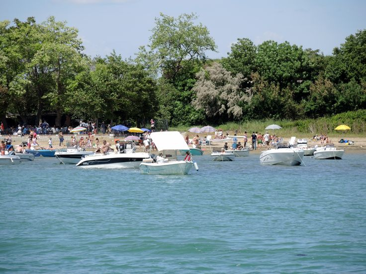 Venetians enjoying a day outdoor at a popular beach in the Island of Sant'Erasmo