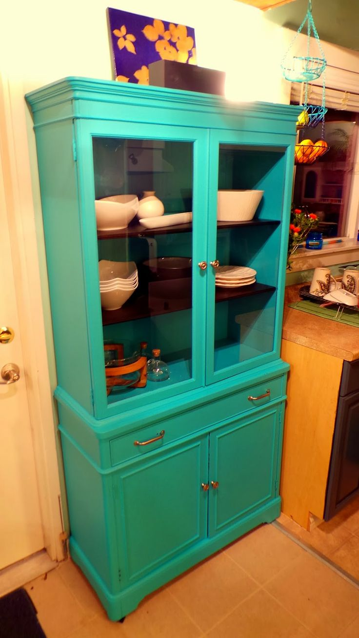 Nine Red: China Cabinet Makeover painted in Behr Cozumel